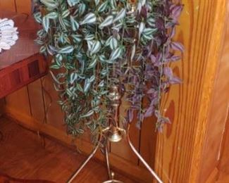 Brass plant stand with foliage