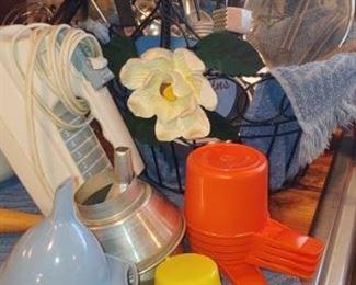 Check out those orange retro Tupperware measuring cups