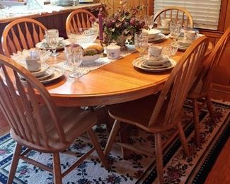 Beautiful solid oak dining room table with Windsor style chairs