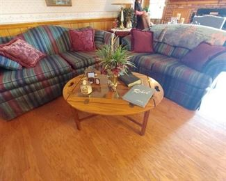 Beautiful living room sofa and loveseat check out that Williamsburg Oak serving coffee table
