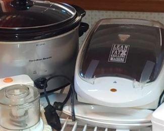 Nice stainless steel crock pot and mean green grilling machine