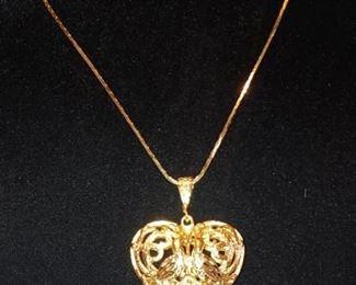 Pretty gold plated filigree heart