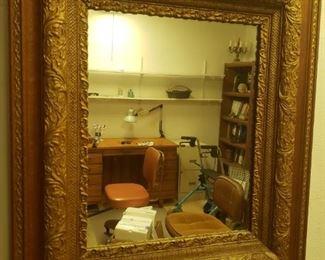 A very pretty gesso/gilded mirror