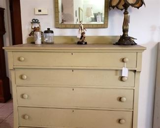 A pretty dresser painted sage green- I think it is mahogany