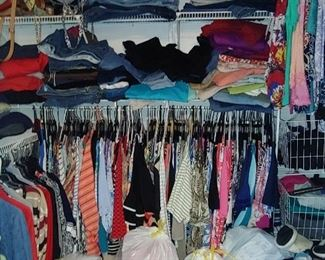 Closet full of designer plus-size clothes ladies