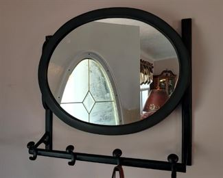 Beautiful oval mirror coat rack