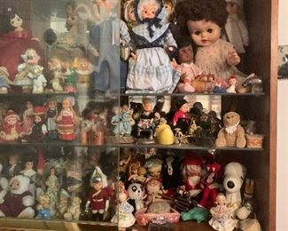 Dolls, dolls, and dolls, this case is stuffed full. ( 8 shelves!) and another case stuffed full! (4 shelves!)