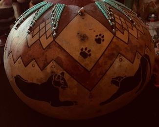 By David Snooks, Washoe tribe.Hand carved, burned and turquoise bead laden gourd