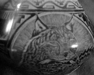 Close up of Santa Clara pot:(difficult to photograph: jewel size) Notice the fine sgraffito carving.