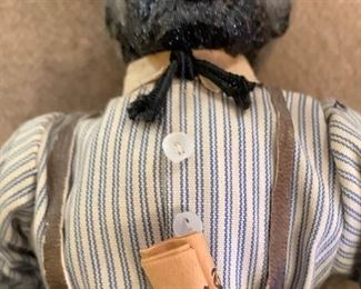 African American doll, holding a newspaper with a Martin Luther King headline.. . hand made clothes