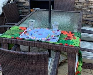 Two rectangular patio sets, each with six chairs
