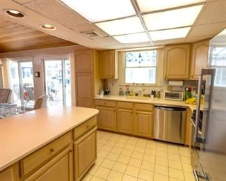 Nice kitchen cabinets; stainless steel GE Profile dishwasher