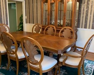 "#1	Fairmount wood dining table w/ 8 chairs and 2 leaves. Excellent condition! 64""-92""x42""x30""	 $425.00"