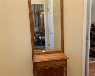 "#4Broyhill oak hall tree with beveled mirror 25""x12.5""x80"" $75.00"