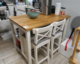 kitchen island with two chairs