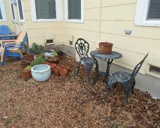 yard items, cast iron patio set, lawn chairs
