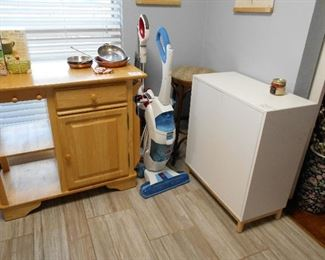 portable kitchen island, cabinet, Shark vacuum,  Hoover floor mate