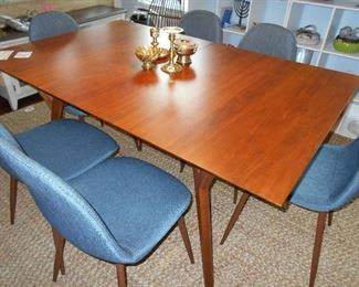 great looking table with leave, chairs are NFS