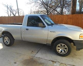 2008 Ford Ranger with manual transmission, six month old new transmission, with large toolbox.