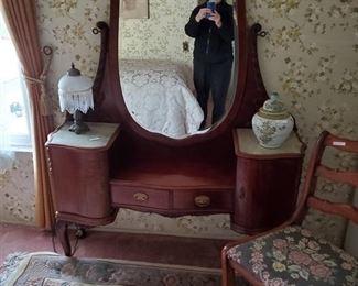 Antique dresser, chair, beautiful rug, lamp, jar