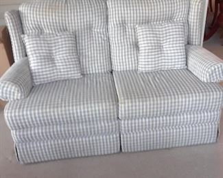 Loveseat upholstered in checked fabric