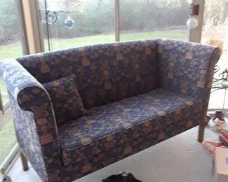 Loveseat upholstered in dark blue fabric