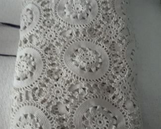 Hand crocheted coverlet made by a member of owner's family