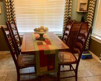 wooden table    ladder back cane seat chairs