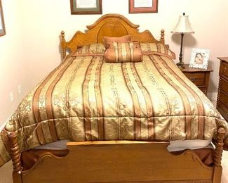 Queen size bed with spindle detail and stripped bedding