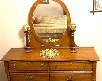 Dresser and mirror with spindle detail and lion pulls