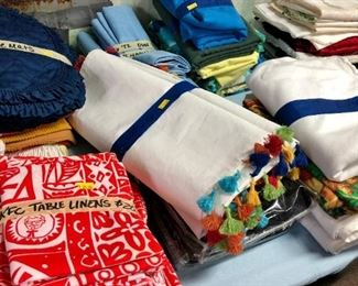 KFC linens, lots of table cloths, round and rectangular.  Table runners.  Some nice vintage pieces