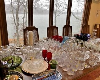 Nice dining table with 2 leafs and table cover pad.  Lots of nice glassware
