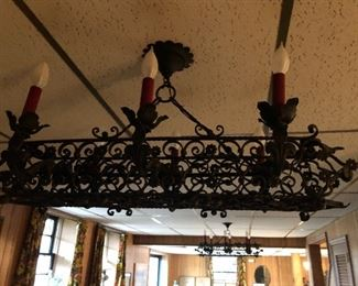 THERE IS A PAIR OF THESE WROUGHT IRON SPANISH GOTHIC. YOUR WINE CELLAR?