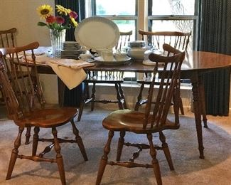 Ethan Allen dining furniture 8 chairs( 6 side, two arm) and dining table with two leaves. drop down ends let you make to square. Never without cushion pads this is in primo condition.
