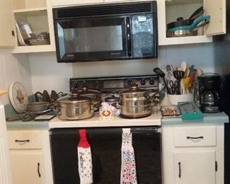 Vintage  Presto  stainless pots and pans, cast iron sad irons. STOVE  AND  MICROWAVE  NOT FOR  SALE!