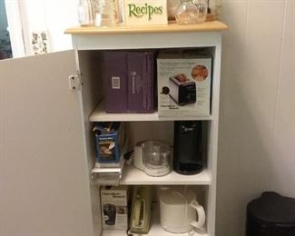 Kitchen cupboard open with small appliances
