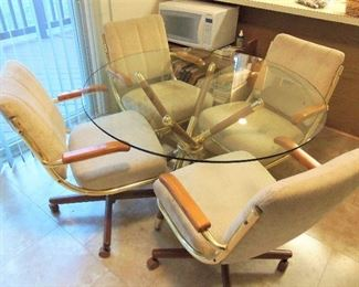 Glass top kitchen table with 4 chairs on casters