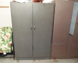 2 metal tall storage cabinets - with rods inside for hanging clothing