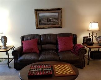 Leather sofa has matching loveseat, chair and ottoman