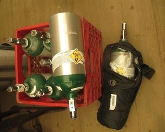 7 portable oxygen tanks and one portable carrying case