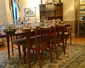 Mid-Century dining table and chairs along with china and crystal from the same era