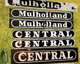 The homeowner worked for Mulholland / Central / Adams Outdoor Advertising.  These signs came from his time at the company.  The top 5 are porcelain, the large Central sign is plexiglass, and the Adams is aluminum.  There is also a fourth porcelain Mulholland sign that is not pictured.