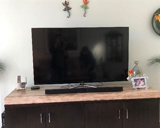 53 HD Smart Tv and sound bar Marble top cabinet