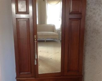 """Master Bedroom: This gorgeous wardrobe has a front mirror door and panel sides with one lower drawer.  It measures 51"""" wide x 21"""" deep x 80"""" tall.  The top cornice piece is removable.  The next photo shows the door open."""