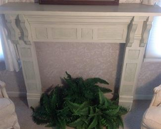 """Master Bedroom: A custom made ivory color portable fireplace surround has carved wood details.  It measures 52-l/2"""" wide x 12"""" deep x 44-3/4"""" tall."""