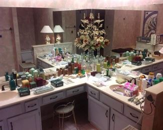 Master Bedroom-Bath:  More candles, candleholders, cosmetic bags, and a brass vanity stool are all displayed.