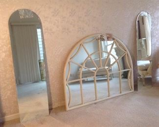 "Master Bedroom:  Two frameless arch top mirrors (16"" wide x 60"" tall) flank a  BALLARD DESIGN wall mirror.  A closer photo of the multi-panel mirror follows."