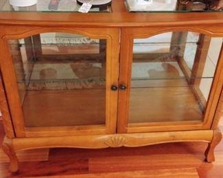 Two door glass shelved cabinet