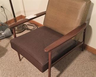 These chairs are mid-century with  thick vinyl seats and backs, wood arms and legs. Very well made.