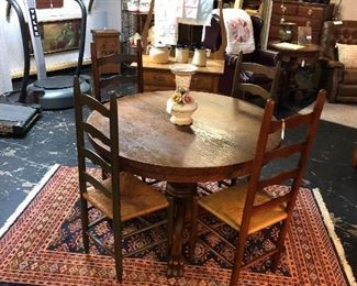 Antique Oak Table on Casters with 4 Ladder Back Cane Chairs